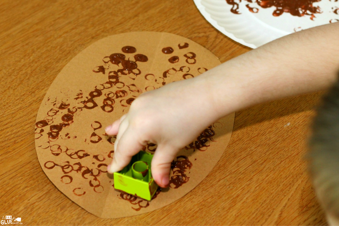 We love to celebrate the beginning of the season by making Fall crafts like this Block Painted Football Craft. This process art activity is fun and easy for young children to create.