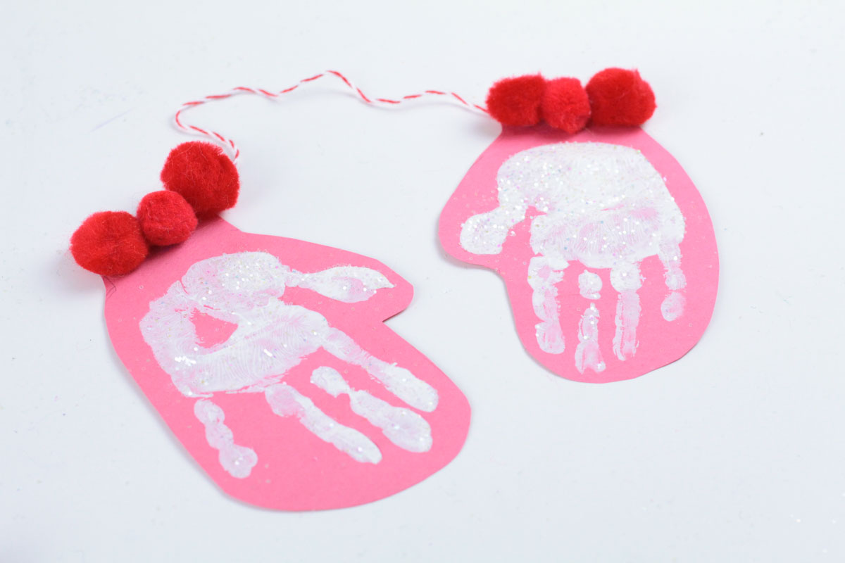 This hand print mitten craft is a variation on the common hand print crafts done during the Christmas season to preserve the appearance of a child's hand.