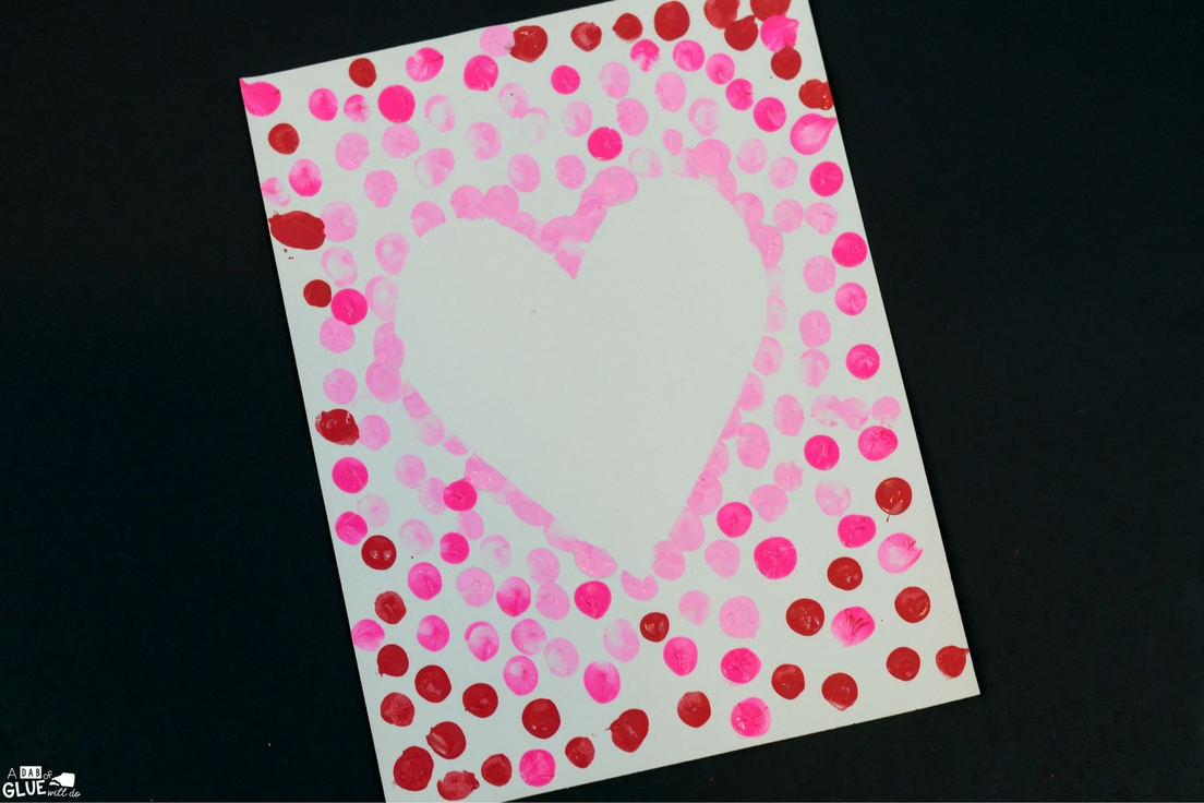 Create this Heart Thumbprint Art in your kindergarten classroom as your next Valentine's Day craft! It's a fine motor Valentine craft idea for kids.