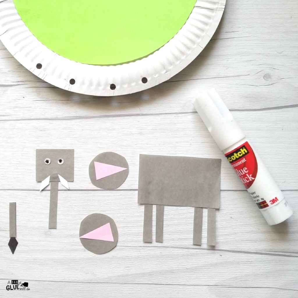Assembling the E is for Elephant Zoo craft.