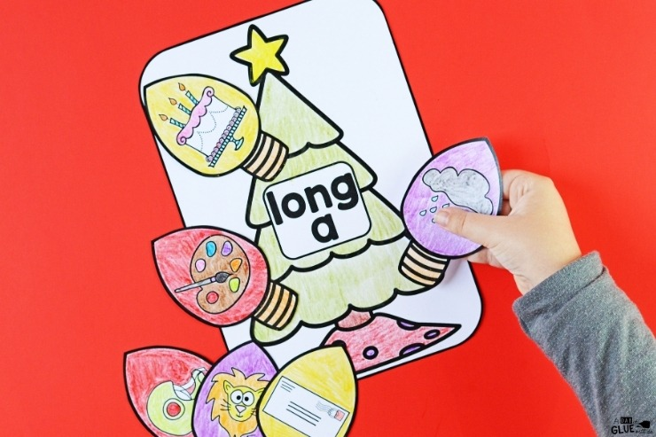 A child completing the Christmas Middle Sound Match-Up activity.