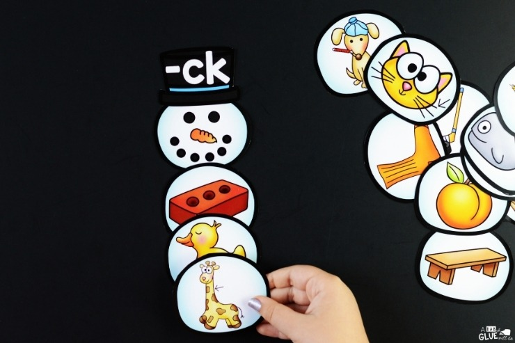 "A child completing the snowman digraph match-up for ""-ck""."